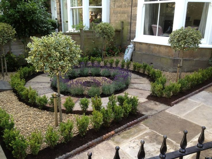The central path was cut from Yorkshire stone and Laid in a petal affect. Box hedge, lavender, holly's and Red Robins completed this design and the finished front garden.