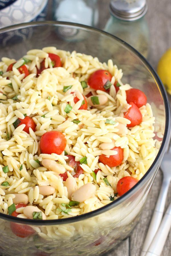 Lemon Orzo Pasta Salad is an easy pasta salad recipe with fresh basil, tomatoes, cannellini beans, and almonds. Great for get-togethers and barbecues!