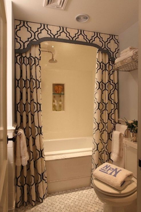 Love the idea of taking the cornice all the way up to the ceiling to that hide the rods & rings.  I always add a second rod for the shower liner.   -k