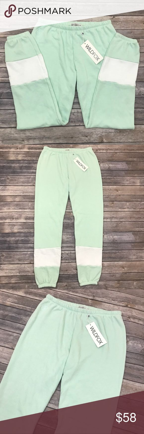 New Wildfox Seafoam Varsity Jogger Sweatpants Wildfox Seafoam Varsity White Label Jogger Sweatpants •New with tags •Size Large •Retails for $98  Check out my other listings- Nike, adidas, Michael Kors, Hunter Boots, Kate Spade, Miss Me, Rock Revival, Coach, Wildfox, Victoria's Slecret, PINK, True Religion, Ugg Australia, Free People and more! Wildfox Pants Track Pants & Joggers