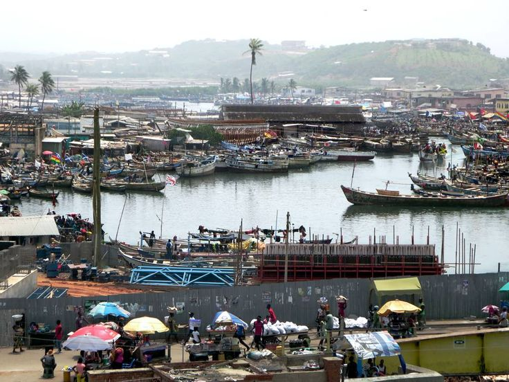 The Benya Lagoon at Elmina, Ghana, is literally packed with pirogues and surrounded by a vast fish market.