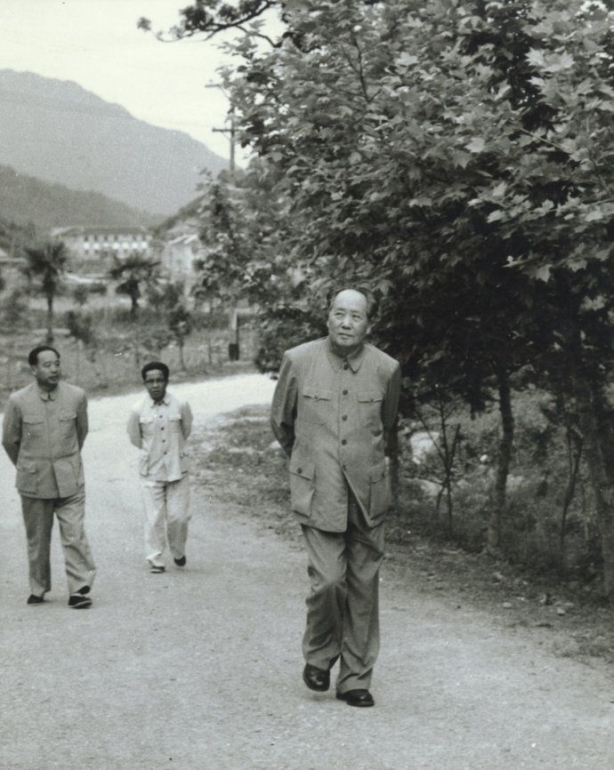 Mao strodes in his hometown, 1965, while his security officer General Wang Dongxi (left behind Mao) stays close behind.