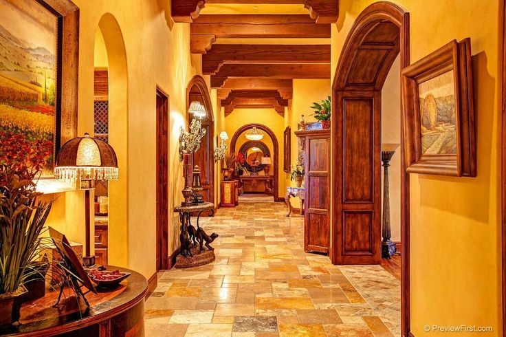 Craftsman Hallway with Exposed beam, Wall sconce, High ceiling, slate tile floors