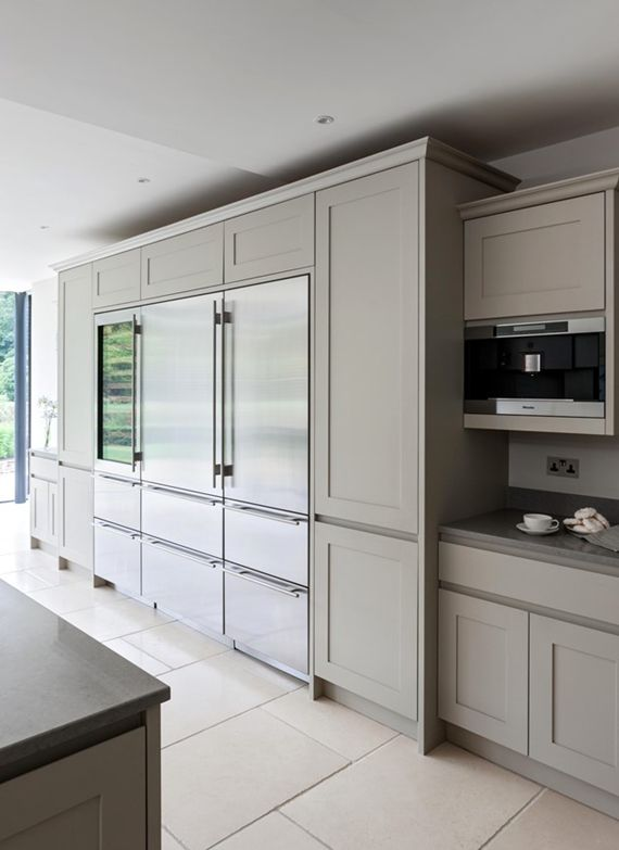 Sub-Zero refrigerators flush with cabinetry in gourmet kitchen // #kitchens