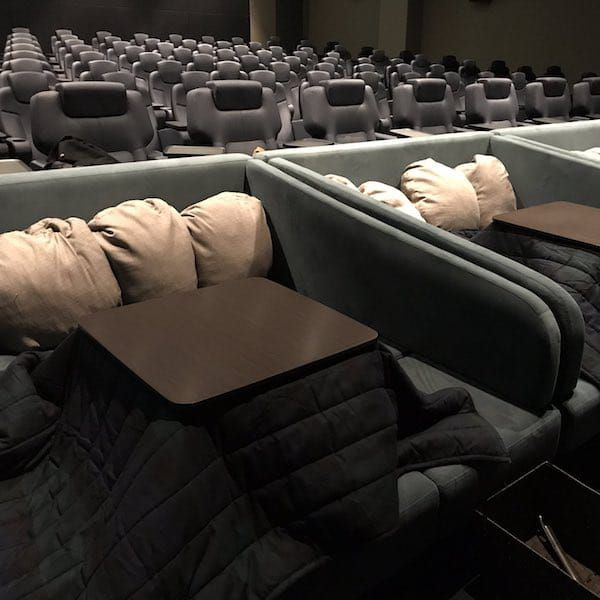 Japanese Movie Theater Keeps Patrons Warm And Toasty With Heated Kotatsu Tables Movie Theater Japan Seating