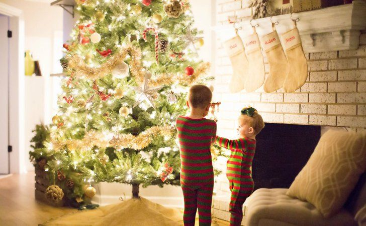 Pin for Later: 14 Holiday Traditions You Should Start With Your Family This Year Wear matching family PJs