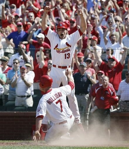 St. Louis Cardinals on-deck hitter Matt Carpenter leaps in the air in celebration as teammate Matt Holliday scores the game-winning run on a single by Yadier Molina in the ninth inning against the Chicago Cubs in a baseball game Tuesday, May 15, 2012, in St. Louis. The Cardinals won 7-6. (AP Photo/St. Louis Post-Dispatch, Chris Lee) EDWARDSVILLE OUT ALTON OUT