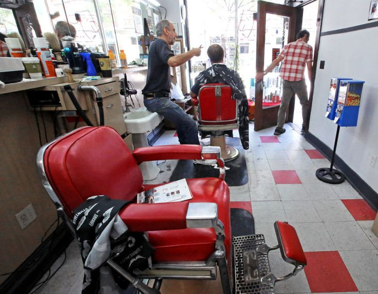 College Barber Shop, 665 State Street, Madison, Wisconsin, closed in September 2014 after nearly 9 decades in business under three ownerships. Fred Lee opened it in 1928, then Don Fine took over in 1969. Larry Cobb (shown above) started cutting hair at the shop in October 1978, and he and a partner acquired it in 2007. Fine kept working there part time until closing, racking up more than 60 years in the trade at age 84. The shop's chairs dated back to 1949. (John Hart photo)