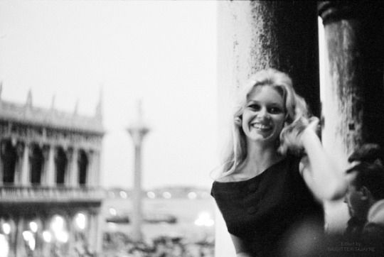 Brigitte Bardot looking at Saint Mark's Square during the 19th Venice International Film Festival. Photographed by Mario De Biasi in August 1958