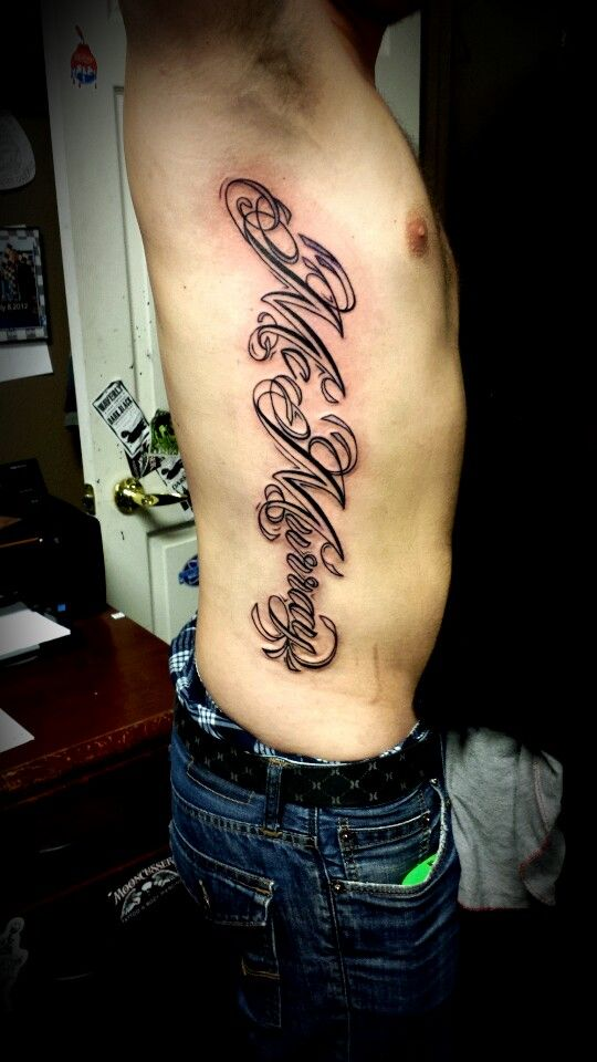 Last name rib piece tattoo tattoos by olivia alden for Last name tattoos on back
