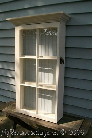 Old Salvaged Window...re-purposed into a prim wall cabinet with a beadboard back.