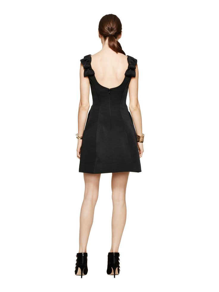 the bow-backed dress is a kate spade new york staple; we love the way that it walks the line between chic and sweet. this black number, with its nipped-in waist and wide neckline, is no exception--and the textured fabric gives it structure, for a feeling of crispness.