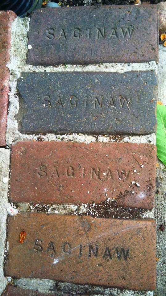 Saginaw bricks. Made by the Saginaw Paving Brick company, these bricks were provided to The YWCA, Schmeltzer Store, Symons Bros. Store, St. Mary's Church, St. Andrews Church, Germania School, Salina School and many more places around town. In 1917 it closed its doors for good, due to the Federal Government deeming the business as non-essential during WWI.