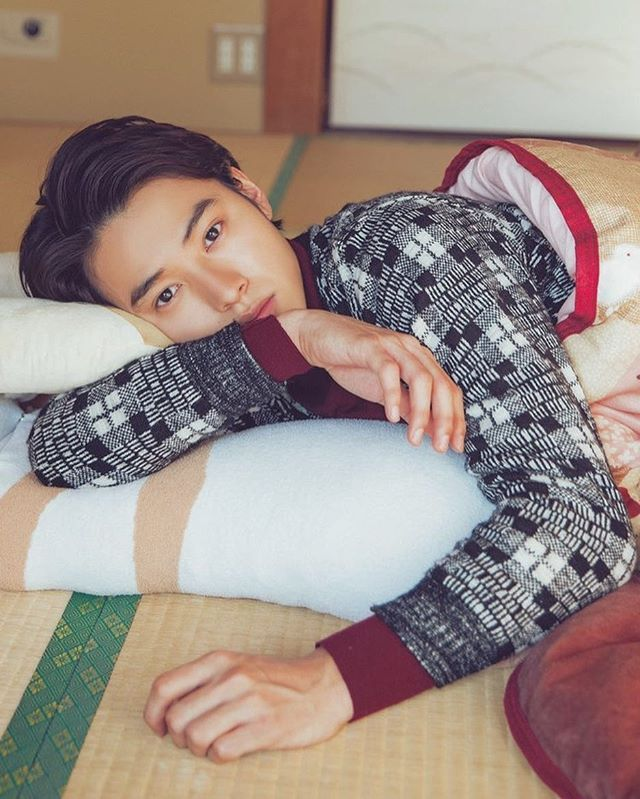 just a picture of Kento Yamazaki laying on the floor, giving you the look you can't resist.