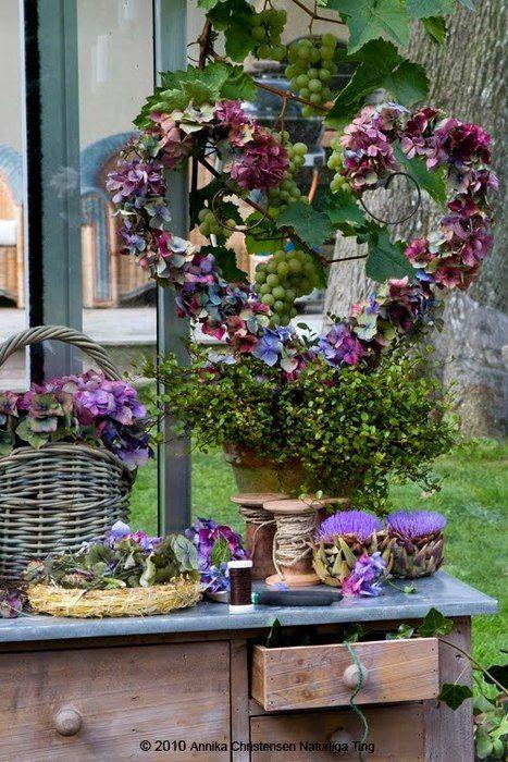 purple wreath, flowers and desk