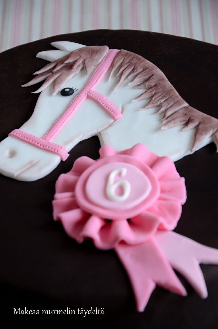 pink and brown horse cake