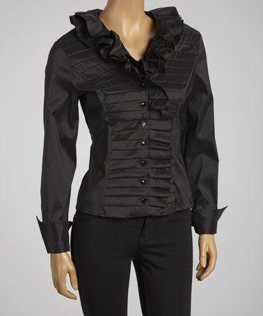 Ruffled black holiday blouse.