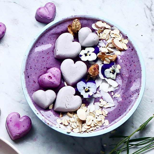 Blackberry and rose smoothie bowl with @sunsol_muesli and raw cake hearts (recipe below). Don't let the advertising and commercialism of the day fool you- there is always a person in your life who deserves love, and can get it without gifts and nonsense: YOU. Spoil yourself, show your mind, body and spirit how much you care, and be a good friend to yourself. If you got time after that, THEN spread the love to those around you.  Blackberry and rose bowl with raw cake hearts  Raw cake hearts…