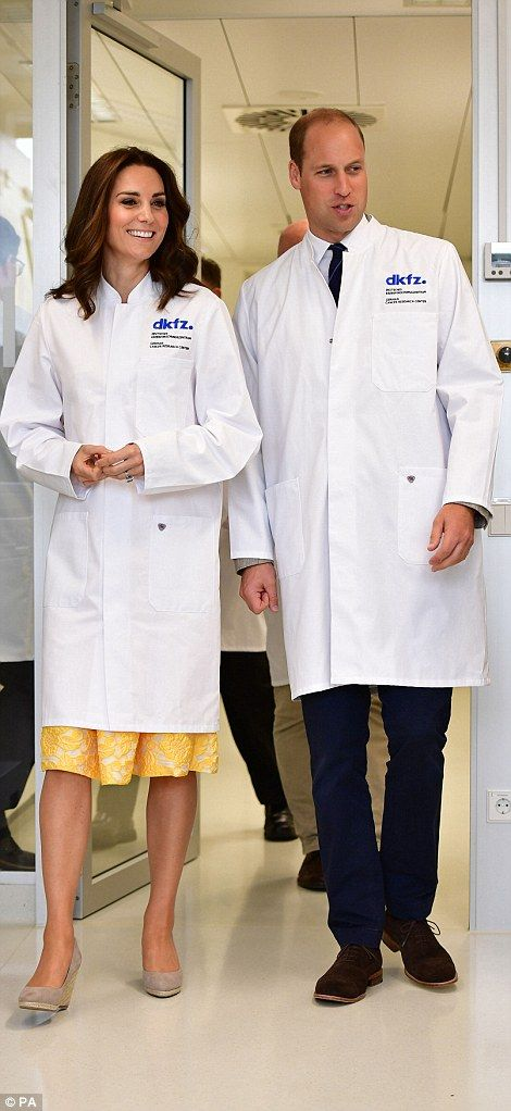 She later donned a white lab coat for a visit to the  German Cancer Research Centre, where...