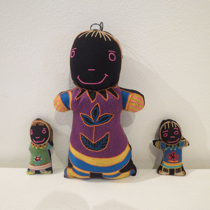 Embroidered dolls and keyrings.