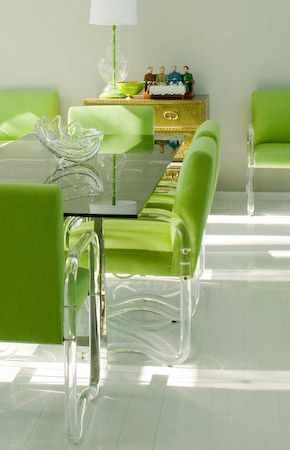 Lucite legs and neon green dining chairs.