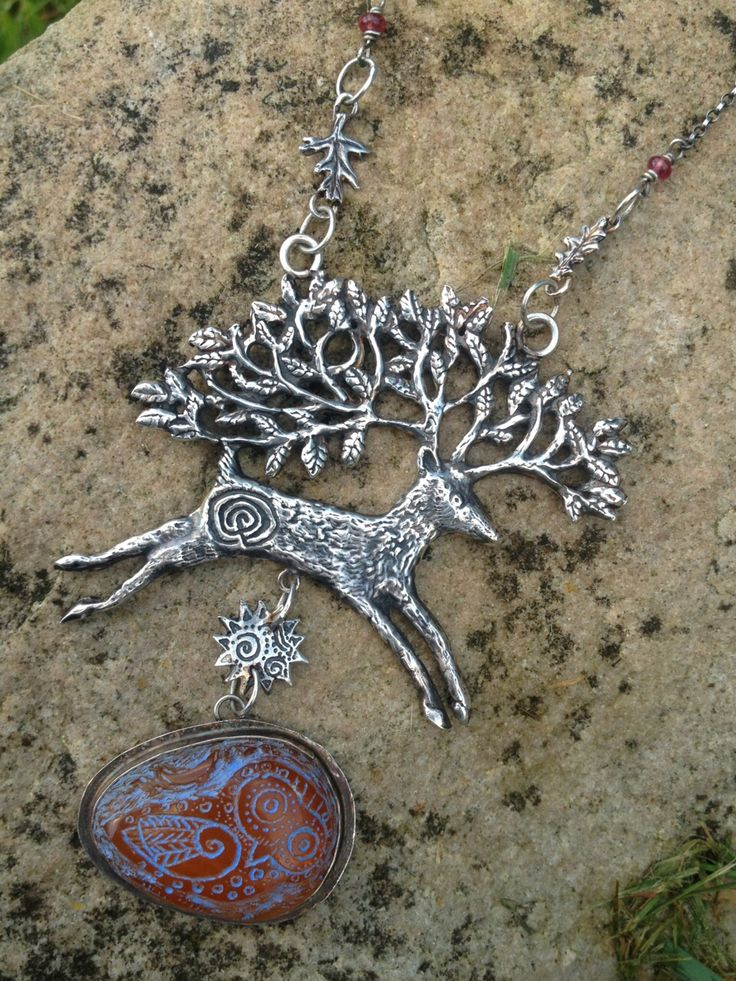 Large silver greenwood stag with carved amber. Hannah Willow Www.hannahwillow.com