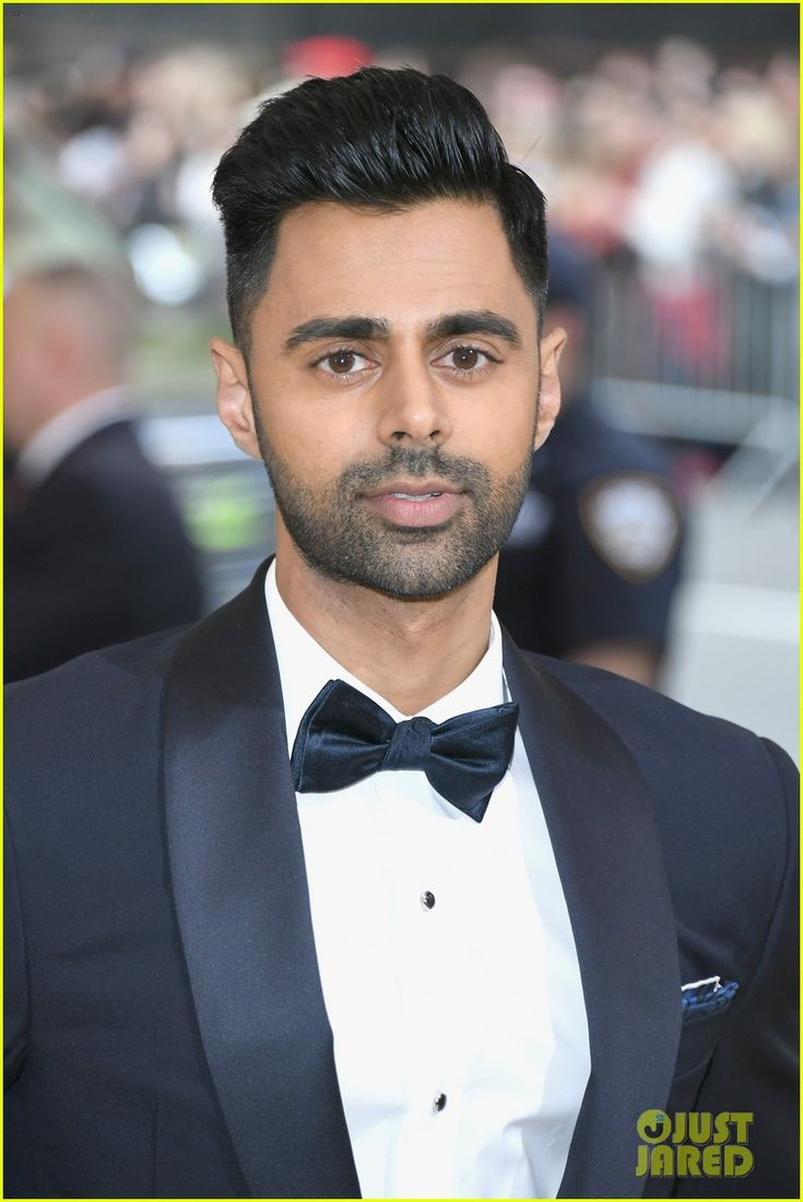Hasan Minhaj is wearing Turnbull & Asser Navy Shawl Collar Tuxedo and Navy Paisley Silk Pocket Square at the Met Gala