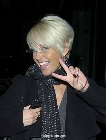 Sarah Harding - pixie - would love to cut my hair this short, but i LOVE my long hair. it is so long you tie in my belt loop. by juicy.e