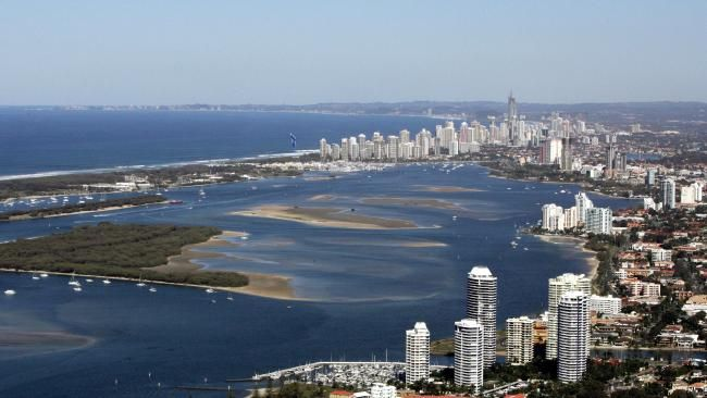 THERE is more evidence the Gold Coast property market is heating up, with some suburbs that enjoy waterfront views experiencing an unprecedented 25 per cent spike in land values.