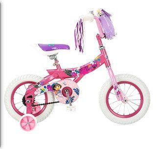 "Nickelodeon Dora the Explorer 12"" Girls' Bike by Nickelodeon. $109.99. Nickelodeon 12"" Girls' Dora the Explorer Bike. Children's sidewalk bike. Equipped with a bell, streamers and a handlebar bag to carry any treasures found along the way, the Nickelodeon Dora The Explorer 12"" Girls' Bike will charm its way into your little girl's heart. The pink colored frame with Dora design and accessories adds the element of attractiveness to this sidewalk bicycle. The screen ..."