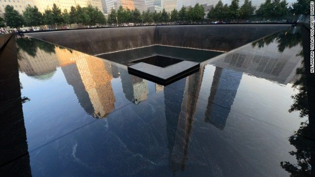 A pool at the 9/11 Memorial in New York reflects surrounding buildings during ceremonies for the 12th anniversary of the terrorist attacks.