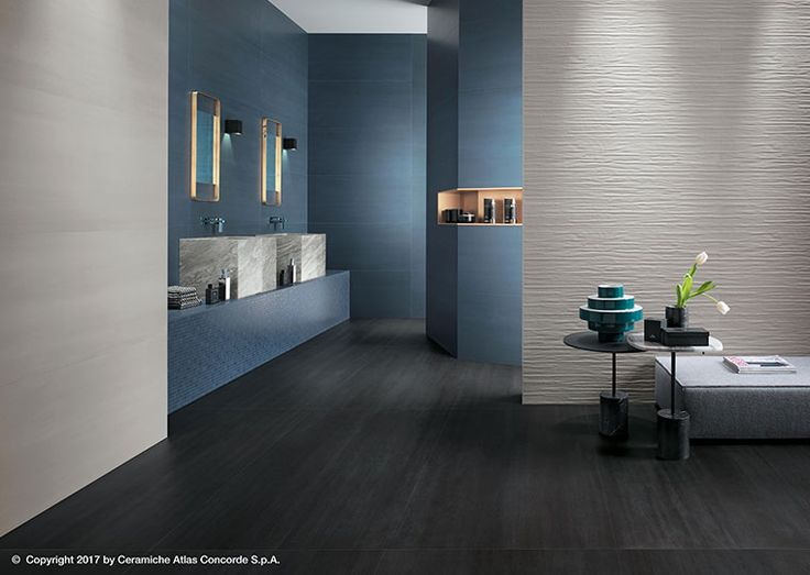 Floor and wall tiles with a metallic concrete look by Atlas Concorde