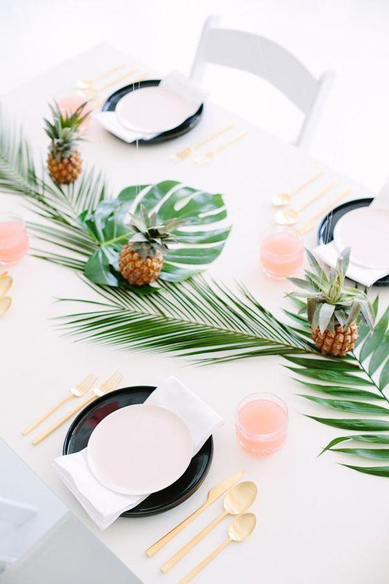 Palm leaf and pineapple wedding decor / http://www.himisspuff.com/green-tropical-leaves-wedding-ideas/4/
