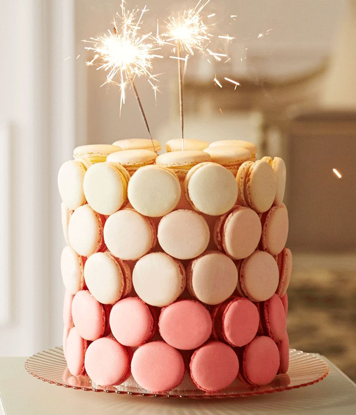Macarons and sparklers make this festive cake anything but ordinary. #Wedding #Cakes