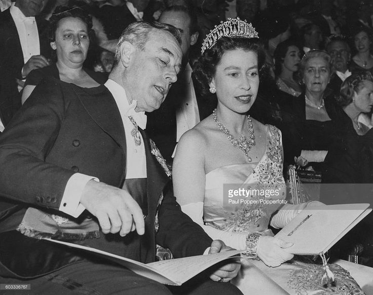 Queen Elizabeth II talks with Louis Mountbatten, 1st Earl Mountbatten of Burma (1900-1979) as they attend the premiere of the film 'Dunkirk' at the Empire Cinema in Leicester Square, London on March 20th 1958. (Photo by Paul Popper/Popperfoto/Getty Images)