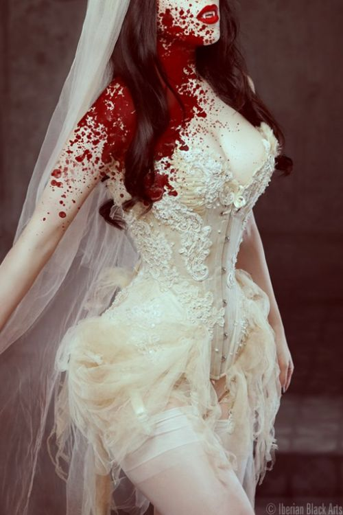 bloody victorian vampire, channelling phantom of the opera and a bit of marie antoinette...totally my style through and through!! halloween costume for sure, especially love the blood all over one side, like it spurted right out of the jugular. i know, i'm dark and twisty.