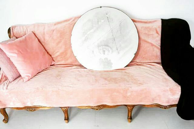Home decor. Vintage peach settee.Vintage round mirror.