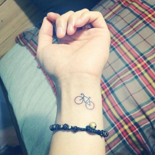 Small minimalist bike tattoo on the left inner wrist. Tattoo...