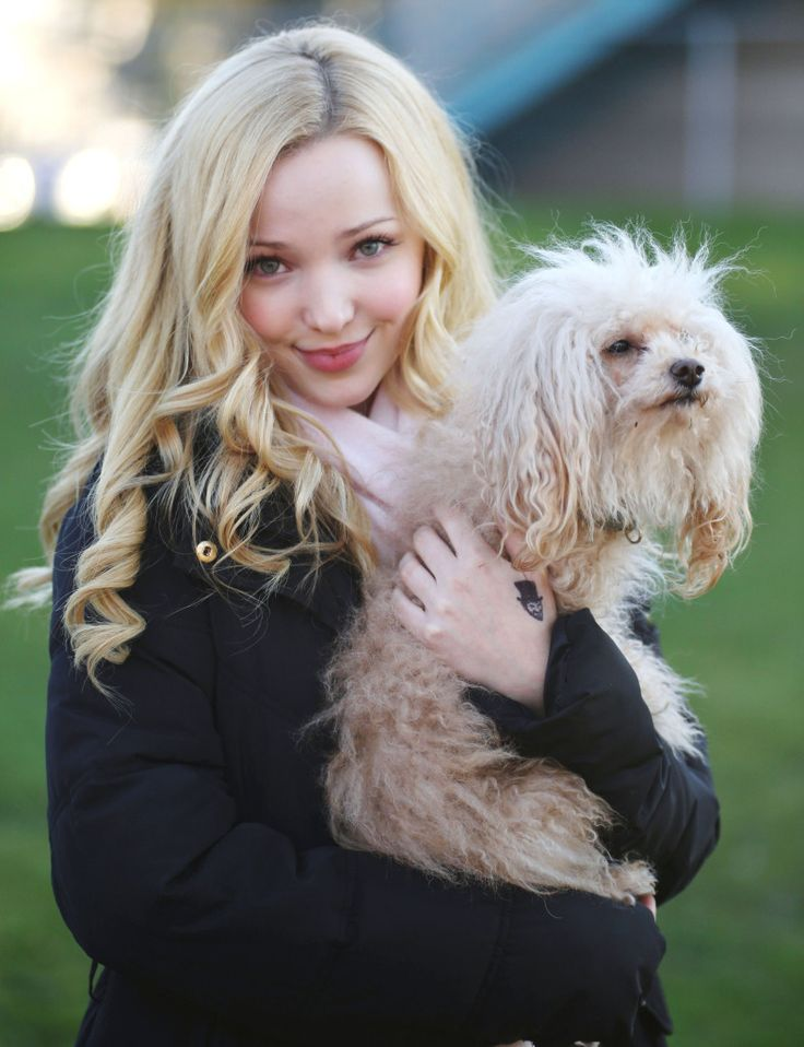 Dove Cameron Takes A Break With Her French Poodle Named Tika On Set On 'Monsterville' On Vancouver - http://oceanup.com/2015/02/25/dove-cameron-takes-a-break-with-her-french-poodle-named-tika-on-set-on-monsterville-on-vancouver/