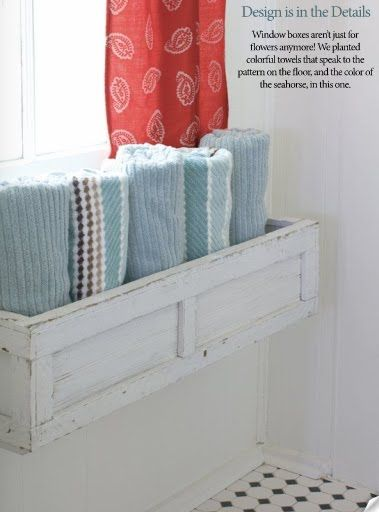 flower box used to store towels in bathroom - Great idea for on top of the radiator - so they would be warm! (if only the cats would stay off of them....)