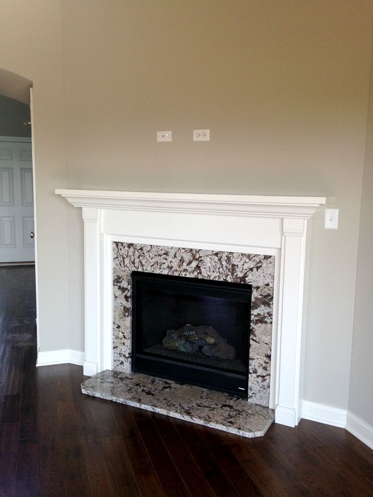 Gas fireplace with granite surround and painted mantle for Marble for fireplace surround