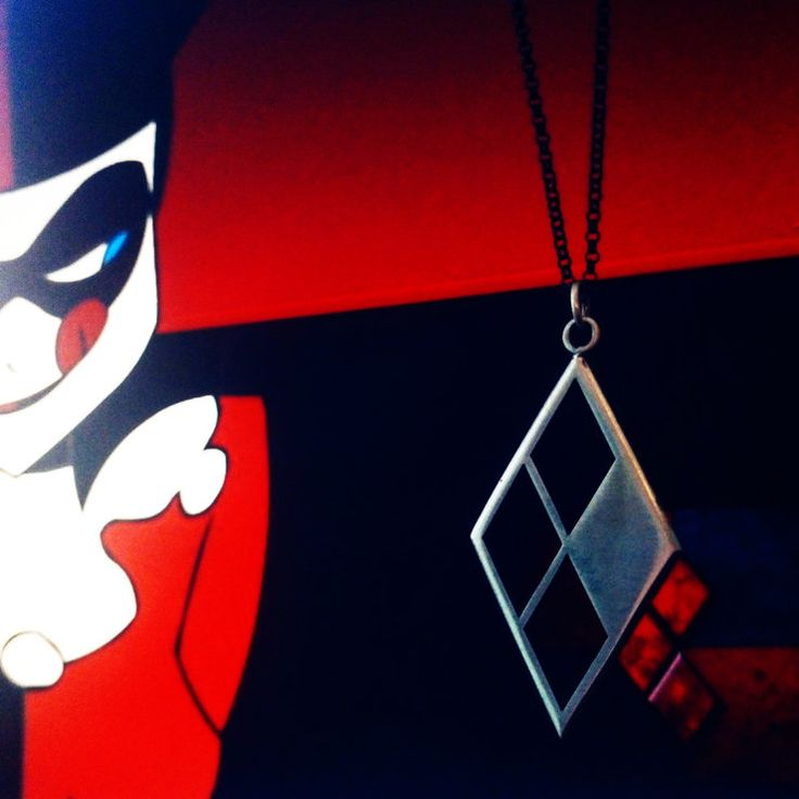 A tribute to Dc Comics Harley Quinn, the bad ass girl  with a sense of humour. Hand crafted from sterling silver on  a sterling silver chain. each pendant comes packaged in a custom branded, limited edition box. All pendants are numbered as with comic books.