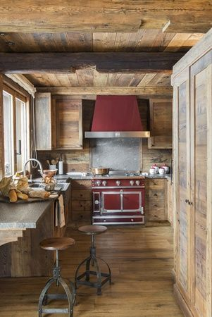 HOME DECOR – RUSTIC STYLE – notice how the red stove stands out against the natural woodwork in this ski chalet.