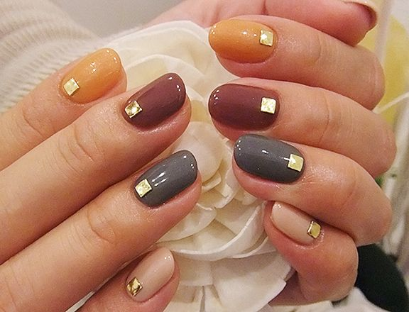 Gold squares on autumnal colours nail art
