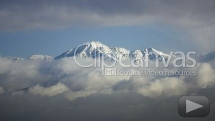 Check out this Snowstorm Mountain Clouds Time-lapse HD Stock Footage Clip. Static shot made at day. Long shot. 2011-04-05, UNITED STATES.