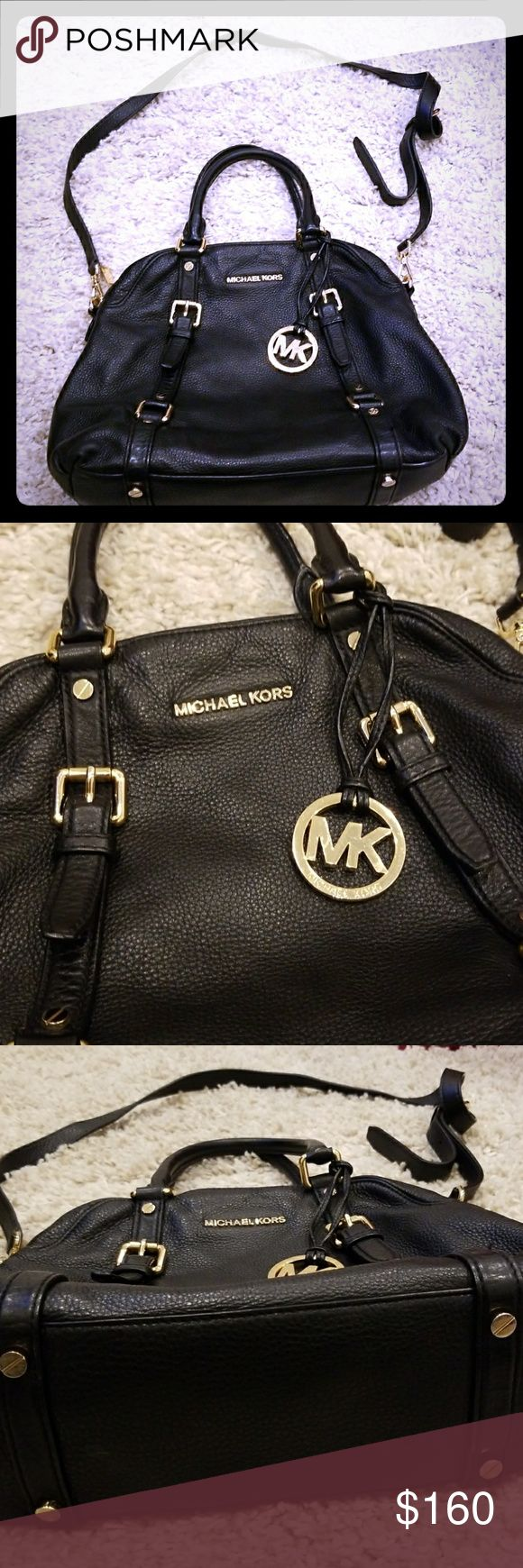 Michael Kors black bag Michael force black leather bag with gold hardware. Top handle and shoulder strap included a pocket on the back lightly worn no scratches or damage to the bag or handles. Perfect condition. Michael Kors Bags Satchels