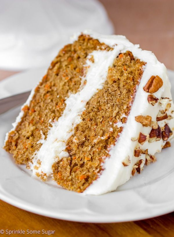 My Favorite Homemade Carrot Cake is extremely moist and flavorful with a hefty coating of my favorite cream cheese frosting!