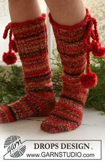 """Lovely DROPS Christmas socks in 2 threads """"Fabel"""" with pompoms in """"Eskimo…"""