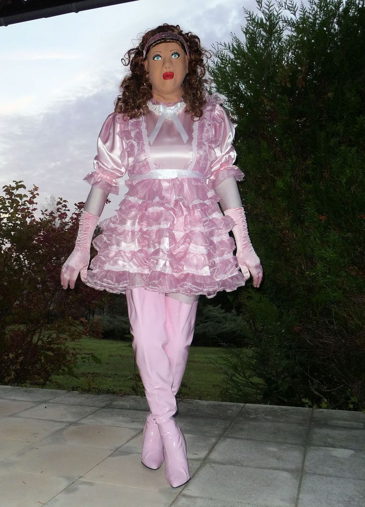 Pink maid goes for a walk. Can she get sissier than this?