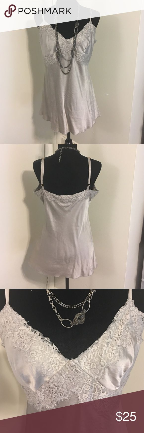 🆕Express Design Studio silver silk cami Express Design Studio silver silk cami- with adjustable straps and lace detailing - truly beautiful blouse to layer or wear alone! Express Design Studio Tops Camisoles